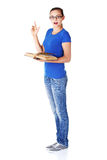 Young casual student woman with book and pointing up. Stock Photo