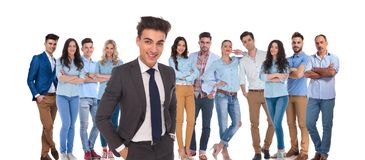 Young casual team with relaxed businessman leader standing in fr royalty free stock photo