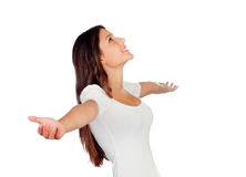 Young casual woman with arms outstretched symbolizing freedom Stock Photo