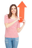 Young casual woman with an arrow Royalty Free Stock Photos