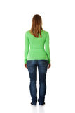 Young casual woman from behind Royalty Free Stock Images