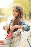 Young casual woman with coffee. Stock Photography