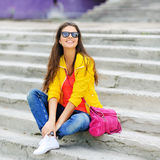 Young casual woman in colorful clothes outdoor portrait Stock Photos