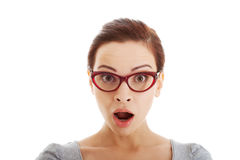 Young casual woman in eyeglasses expresses shock. Royalty Free Stock Photo