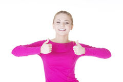 Young casual woman gesturing thumbs up. Stock Image