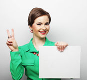 Young casual woman happy holding blank sign Stock Photography