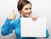 Young casual woman happy holding blank sign Royalty Free Stock Photos