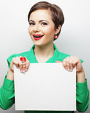 Young casual woman happy holding blank sign Royalty Free Stock Photo