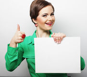 Young casual woman happy holding blank sign Stock Photos