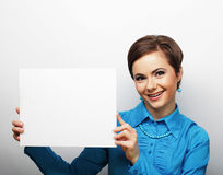 Young casual woman happy holding blank sign Royalty Free Stock Image