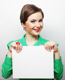 Young casual woman happy holding blank sign Royalty Free Stock Images