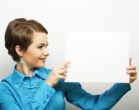 Young casual woman happy holding blank sign Stock Image
