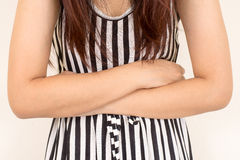 Young casual woman is having stomach ache. Royalty Free Stock Images