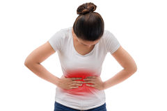 Young casual woman is having stomach ache. Isolated on white background with clipping path Royalty Free Stock Photography