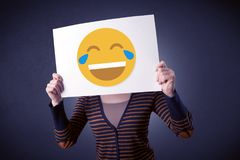 Woman holding paper with laughing emoticon Stock Images
