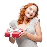 Young casual woman hoding christmas gift Royalty Free Stock Images