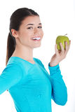 Young casual woman holding an apple. Royalty Free Stock Images