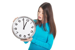 Young casual woman is holding a clock. Royalty Free Stock Photography