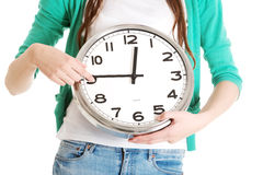 Young casual woman holding clock. Royalty Free Stock Photos