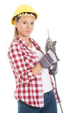 Young casual woman holding drill and wearing safety helmet. Isolated on white Royalty Free Stock Photography