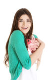 Young casual woman holding piggy-bank. Stock Photos