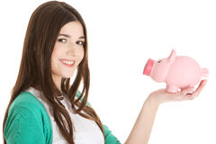 Young casual woman holding piggy-bank. Stock Images