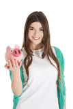 Young casual woman holding piggy-bank. Stock Image