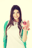 Young casual woman holding piggy-bank. Royalty Free Stock Image
