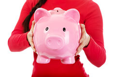 Young casual woman holding a piggybank Stock Image