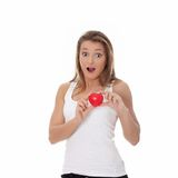 Young casual woman holding red heart Stock Photography