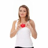 Young casual woman holding red heart Royalty Free Stock Photos