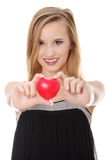Young casual woman holding red heart. Stock Photos