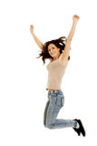 Young casual woman jumping. Stock Images
