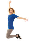 Young casual woman jumping. Royalty Free Stock Photography