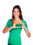 Young casual woman making a heart with her hands Royalty Free Stock Photography