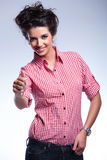 Young casual woman making the thumbs up ok sign Royalty Free Stock Photography