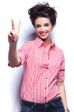 Young casual woman making the victory sign Stock Photo