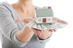 Young casual woman with money and house. Royalty Free Stock Photos