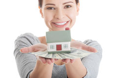 Young casual woman with money and house. Stock Photography