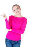 Young casual woman pointing aside. Stock Image