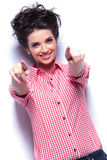 Young casual woman pointing her fingers Stock Photography
