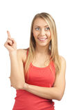 Young casual woman pointing up Royalty Free Stock Photography