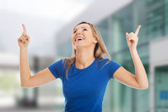 Young casual woman pointing up. Stock Image
