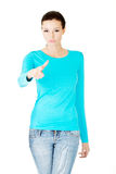 Young casual woman pointing on you. Royalty Free Stock Photography