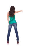 Young casual woman points finger Stock Photography