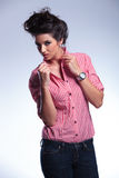 Young casual woman pulling her collar Royalty Free Stock Photo