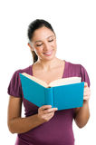 Young casual woman reading a book Stock Photography