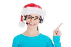 Young casual woman in santa hat and,microphone and headphones. Isolated on white Stock Images
