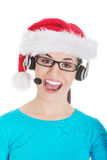 Young casual woman in santa hat and,microphone and headphones. Isolated on white Royalty Free Stock Image