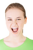 Young casual woman screaming with anger. Isolated on white Royalty Free Stock Image
